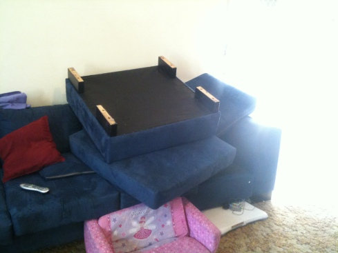 The footrest end of the couch upturned to make room