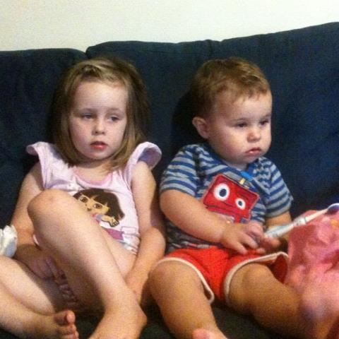Daniel keeping his poor sick sister company on the couch whilst watching cartoons