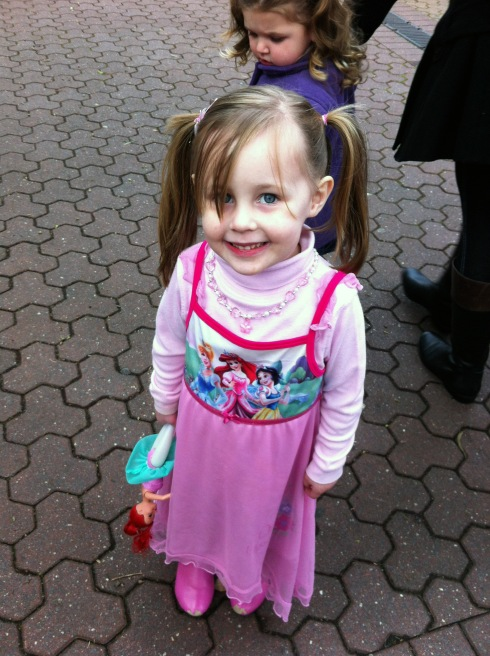 Not only was she wearing a princess dress, but she also brought her Ariel doll.