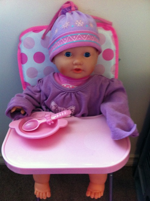 Leah in her high chair