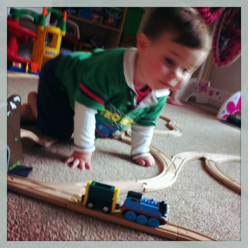 Watching Thomas chuff around the tracks.  I finally got him to wear his Thomas shirt without screaming!