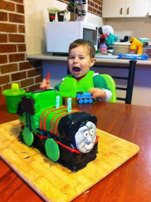 Daniel amazed at his Percy cake.  Percy's face broke when I put it on and I didn't want to make another one.