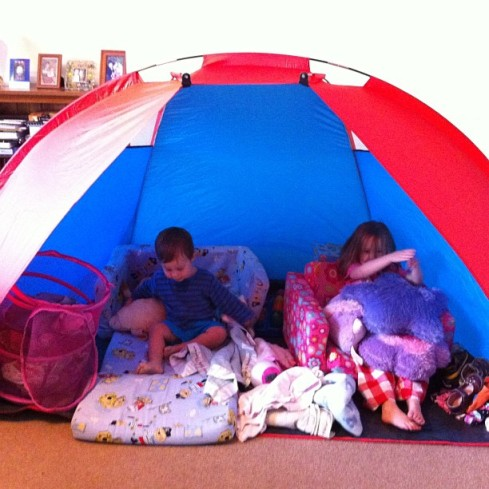Hannah and Daniel love it when I set the tent up in the backyard.  And sometimes when we're bored and it's rainy, we set it up in the living room.