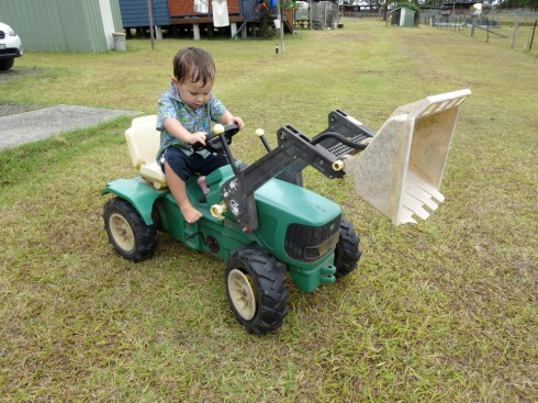 Daniel on the pedal tractor