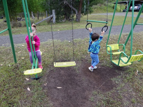 The kids enjoying the swingset
