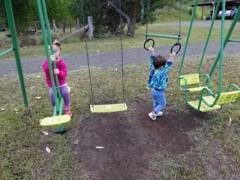 The kids enjoying the swingset