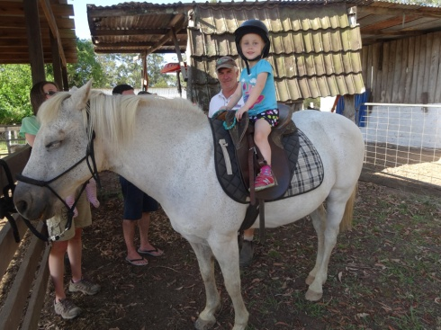 Hannah riding a horse.  Maybe it was a pony, I'm not sure what breed/height it was