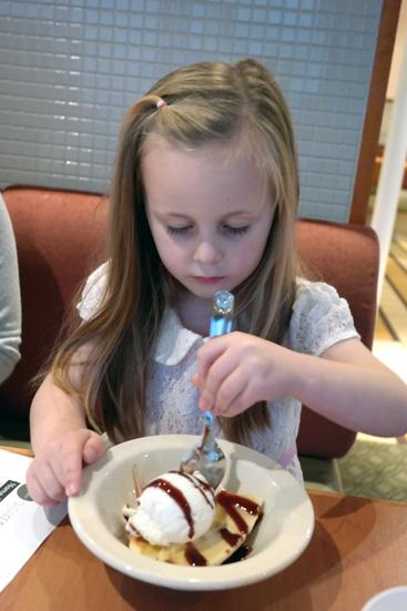 Hannah having dessert