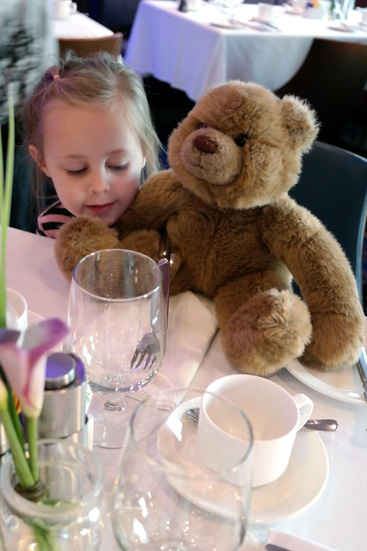 Hannah and the bear from school at breakfast (they each get a turn taking the bear home for a week.  She got to take it on the cruise)