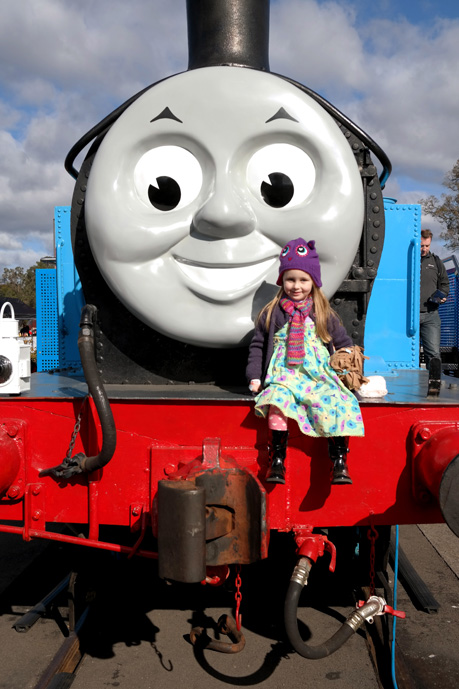 Hannah sitting on Thomas.  Daniel wanted to look at Thomas but was too scared of his large size to actually go near him (which is funny since Daniel's favourite thing ever is Thomas)