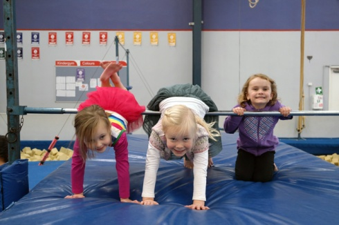 Hannah and two of her friends at the gymnastics party